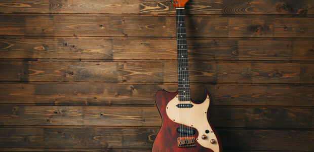Electric,Guitar,On,Wooden,Background